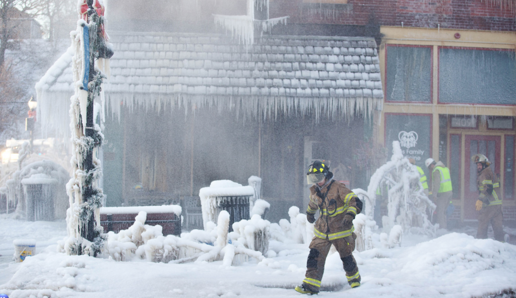 Ice covers the Waterman Opera House building in Plattsmouth, Neb., on Friday, Jan. 3, 2014. The building was damaged by a late night fire. By: RYAN SODERLIN/THE WORLD-HERALD